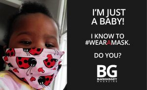 baby wearing a mask